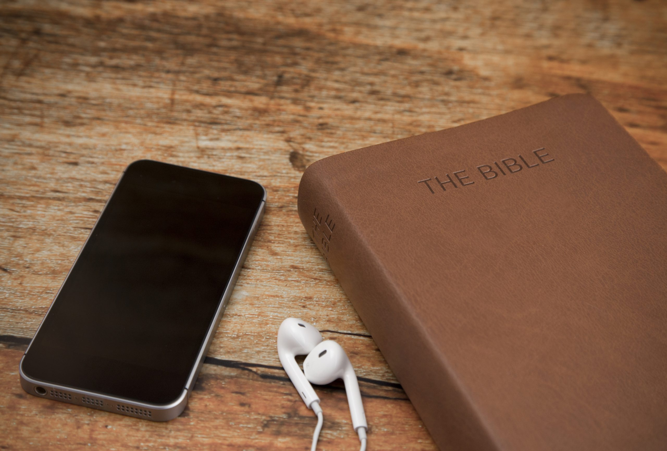 Bible and phone - earplugs